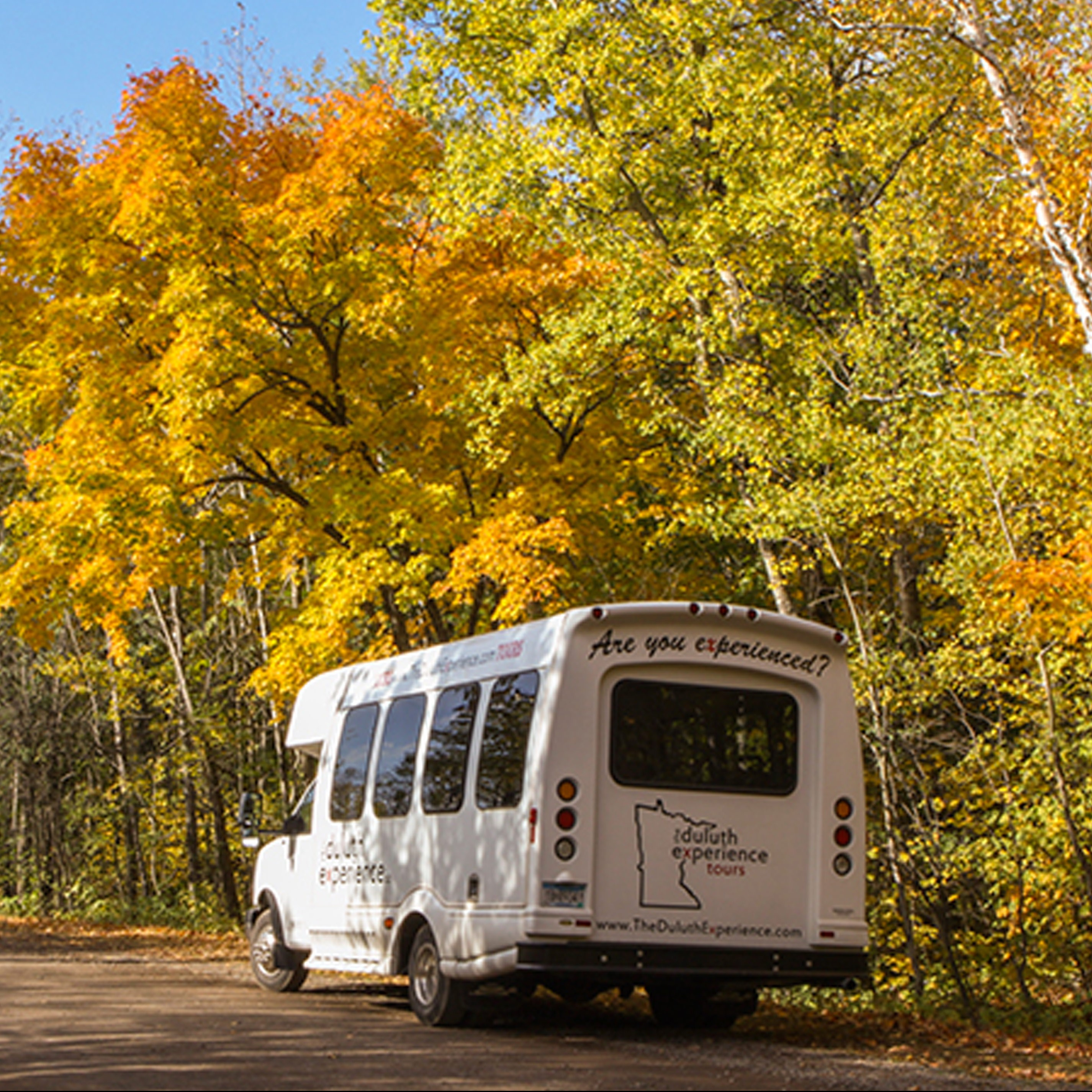 Duluth Experience Tours van during fall