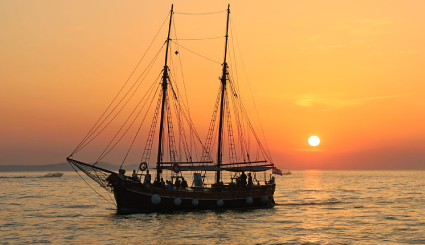 Tall Ship sailing at sunset on the Great Lakes