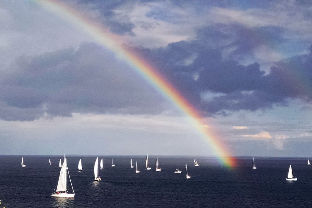 Lake Superior sailboat race under a rainbow