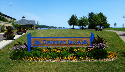 Downtown Lakewalk sign in summer bloom