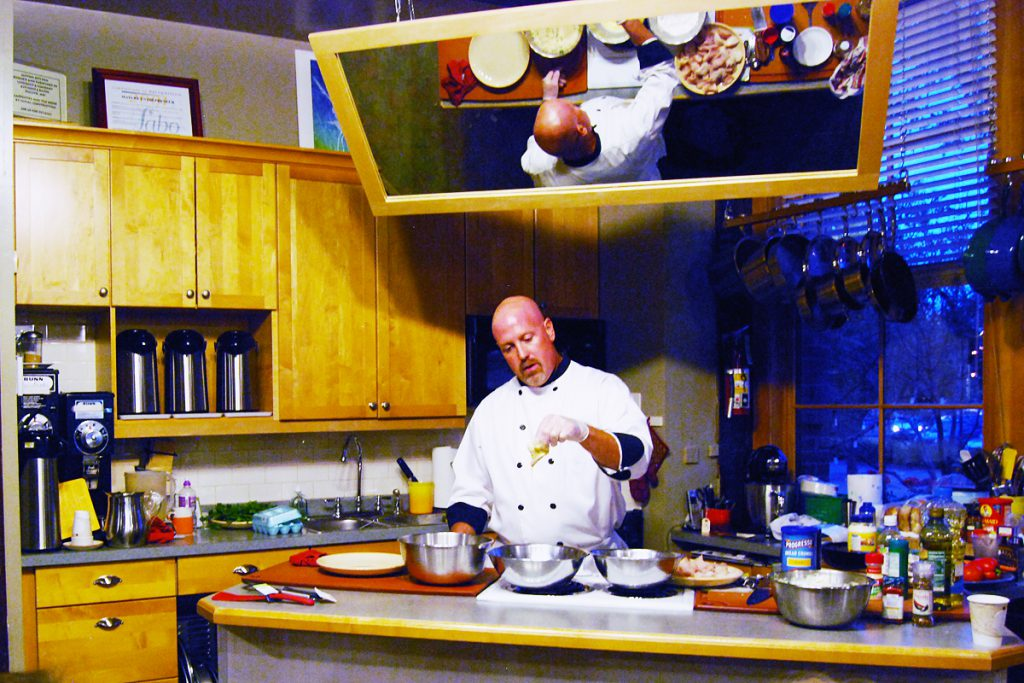 Chef Patrick Moore conducting a fresh fish cooking class at Blue Heron Trading Co.
