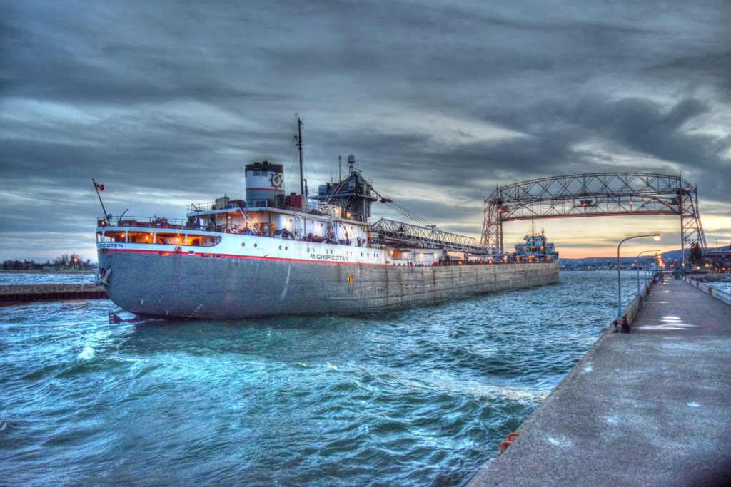 Michipicoten sailing under the Duluth Aerial Lift Bridge